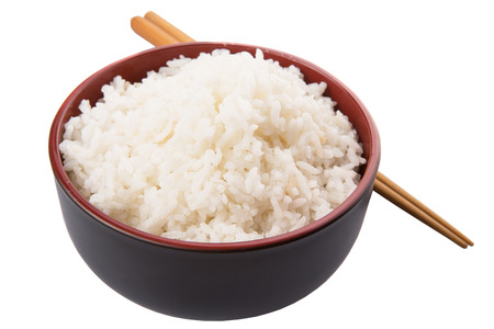 cooked rice: A bowl of rice and a pair of chopstick over white background
