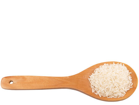 wooden spoon: Raw and uncooked rice in wooden spoon over white background
