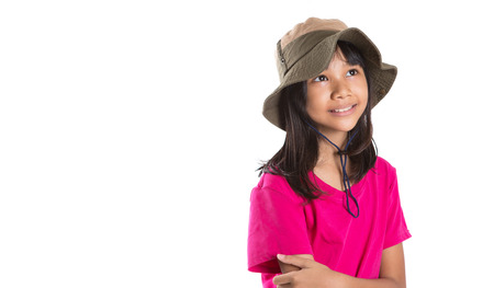 asian preteen: Young Asian preteen girl wearing angler hat and pink tshirt over white background Stock Photo