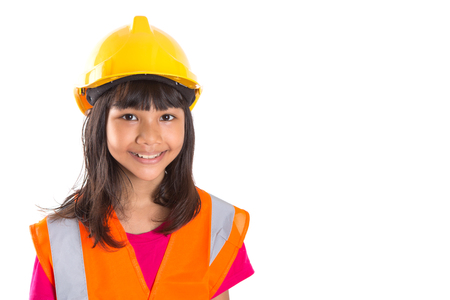 Young preteen Asian girl with hard hat and reflective vest over white background photo