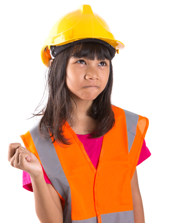 Young preteen Asian girl with hard hat and reflective vest over white background