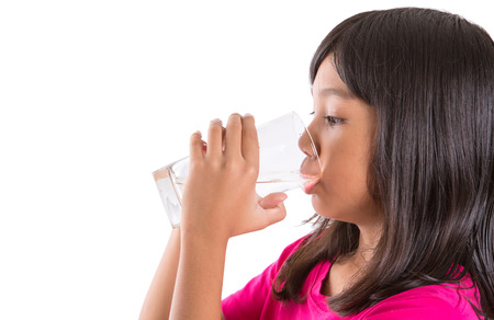 preteen  pure: Young Asian preteen with a glass of water over white background Stock Photo
