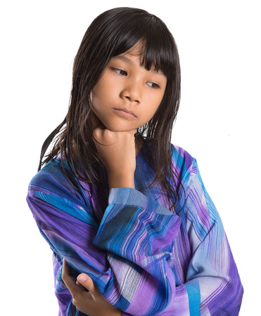 asian preteen: Young preteen Asian girl in Malay traditional dress baju kurung over white background Stock Photo
