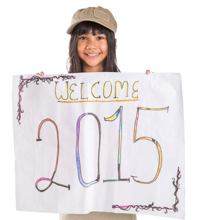 Young Asian preteen girl with poster of welcoming New Year 2015