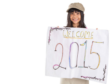 Young Asian preteen girl with poster of welcoming New Year 2015 photo