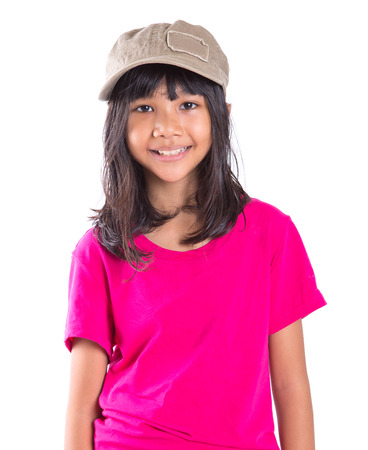 Young preteen Asian girl with a cap over white background