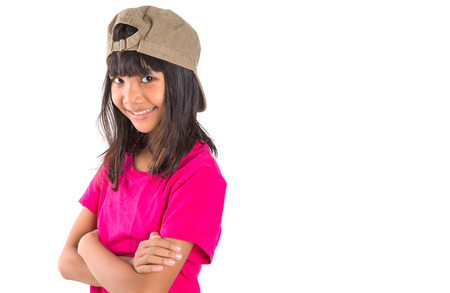 preteen asian: Young preteen Asian girl with a cap over white background