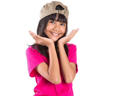 teen girl brown hair: Young preteen Asian girl with a cap over white background