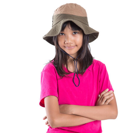 Young Asian preteen girl wearing angler hat and pink tshirt over white background Stock Photo