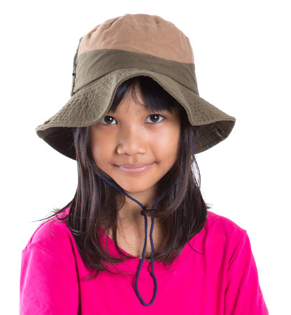asian style: Young Asian preteen girl wearing angler hat and pink tshirt over white background Stock Photo