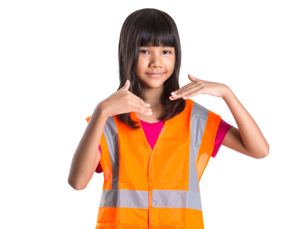 asian preteen: Young Asian preteen girl with an orange safety reflective vest over white background Stock Photo