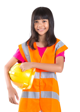 working model: Young preteen Asian girl with hard hat and reflective vest
