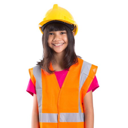 Young preteen Asian girl with hard hat and reflective vest photo