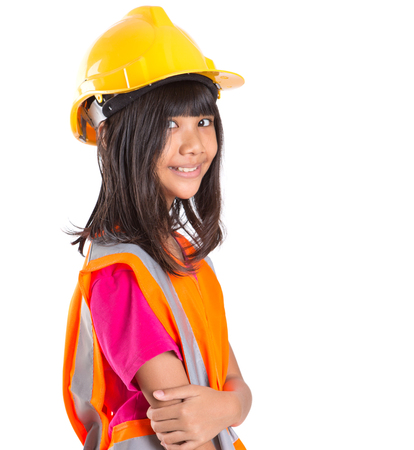 asian preteen: Young preteen Asian girl with hard hat and reflective vest