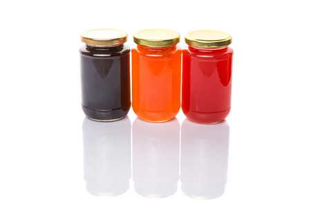Blueberry, strawberry and orange fruit  bottled jam photo