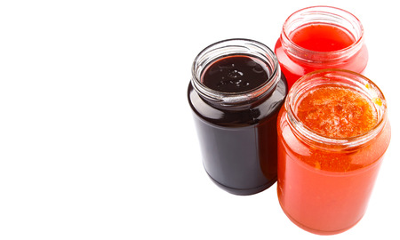 Blueberry, strawberry and orange fruit open lid bottled jam photo