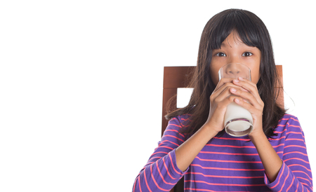 asian preteen: Young Asian preteen girl with a glass of milk