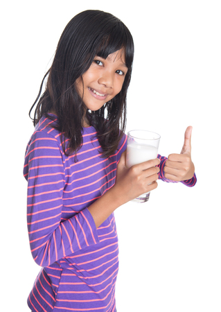 preteen girl: Young Asian preteen girl with a glass of milk