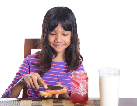 malay food: Young Malay Asian preteen girl having breakfast