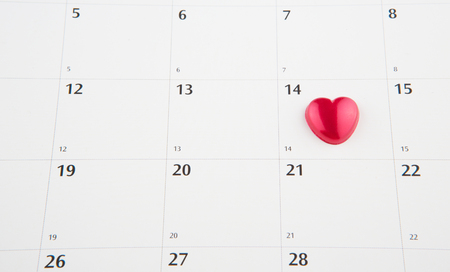 Red heart shape symbol on the February 14th date on a calendar for Valentine\\ photo