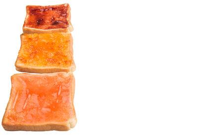 Mix fruit, blueberry, orange fruit jam spread on bread toast over white background photo