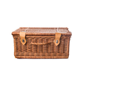 Handmade wicker picnic basket over white background photo
