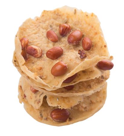 javanese: Rempeyek or peyek, a popular traditional deep-fried savoury Malaysian Javanese cracker over white background