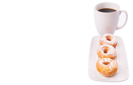 A mug of coffee and homemade doughnut with sugar toppings  photo