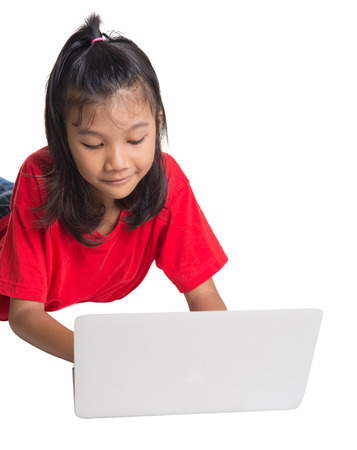 computer model: Young Asian girl with a laptop over white background