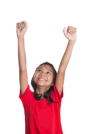 Young Asian girl raising her hands over white background photo