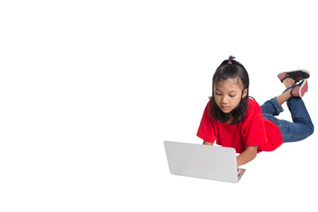 asian preteen: Young Asian girl with a laptop over white background