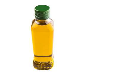 A bottle of olive oil over white background photo
