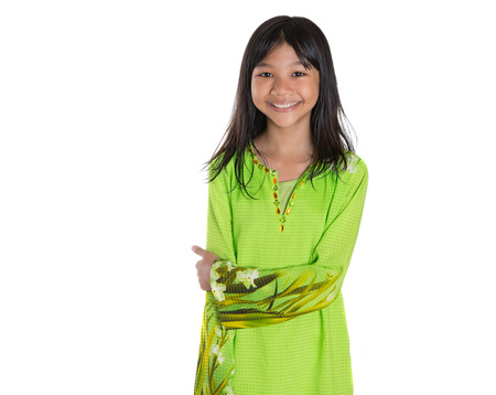 Teenage Asian Malay girl in traditional dress over white background Stock Photo