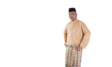 Middle age Malay man in traditional attire over white background