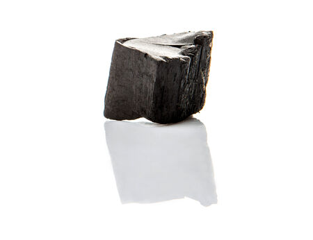 lump: Lump of charcoal over white background
