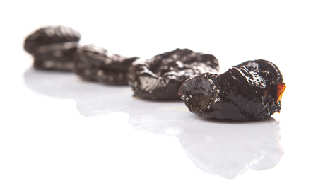 prune: Dried plum or prune over white background