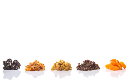 Mix dried fruit variety over white background photo