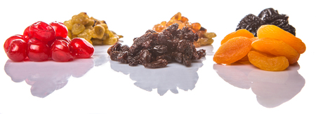 Mix variety of dried fruit over white background photo