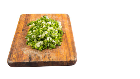 scallions: Spring onion or scallions on wooden cutting board over white background