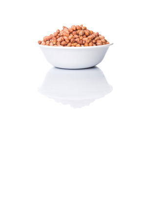ground nut: Peanut or ground nut in white bowl over white background