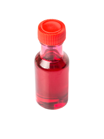 additive: Liquid light red food color additive over white background