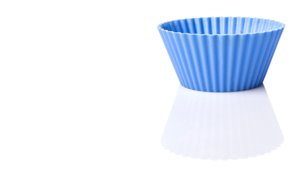 silicone: Blue silicone cupcake silicone baking cups over white background