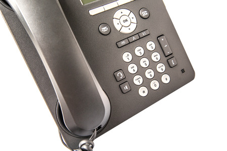 telephone receiver: Modern desktop telephone receiver over white background