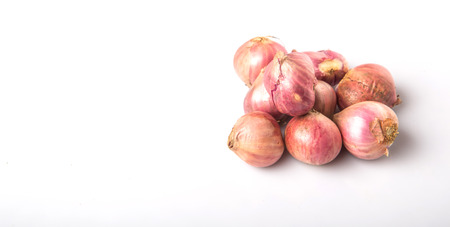 teary: Indian small red onions over white background