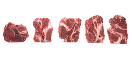 frozen meat: Chunk of cut frozen beef meat over white background