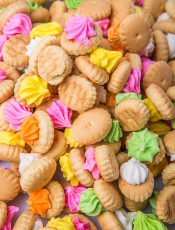 belly button: Belly button iced gem biscuits over white background