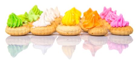 ombligo: Belly bot�n helado galletas gema m�s de fondo blanco Foto de archivo