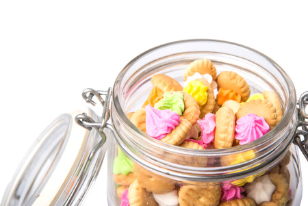 belly button: Belly button iced gem biscuits in a glass jar Stock Photo