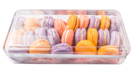 French macaron in a plastic box container photo