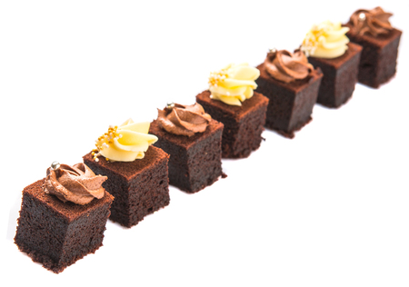 Bite sized chocolate cake with chocolate and cream cheese toppings Stock Photo